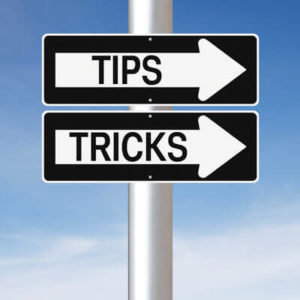 sign with tips and tricks written on them